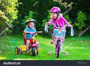Kids Riding Bikes Park Children Enjoy Stock Photo ...