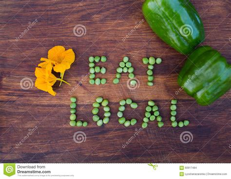 sign eat local made of green peas on wooden background stock 60917484