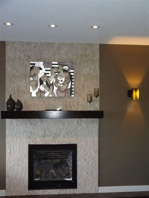 Gas fireplace with split face travertine tiles   Fine