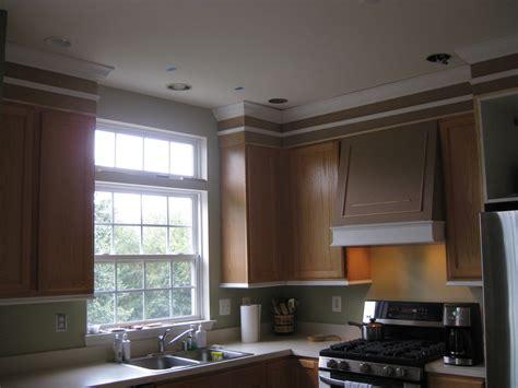 adding trim to kitchen cabinets remodelando la casa adding moldings to your kitchen cabinets