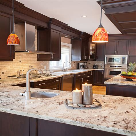 what is the least expensive countertop wood cabinets which granite colors will match them best