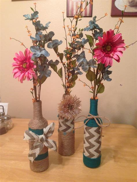 wine bottle diy crafts wine bottle crafts diy for the home pinterest wine bottle flowers chevron ribbon and flower
