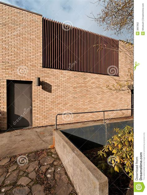 Brick Building Exterior With Vertical Wood Grille Stock