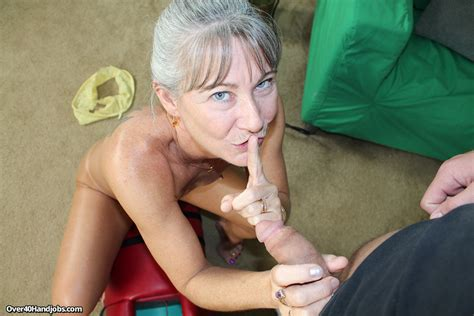 Sexy Granny Jerks Off Her Step Son While Riding Her