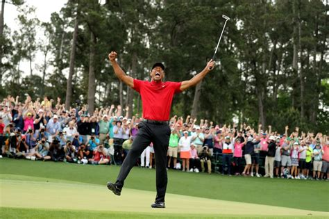 Golf: Woods wins Masters to claim first major in 11 years