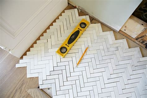 cutting mosaic tile how to install a marble herringbone fireplace surround and