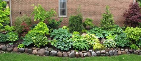 hosta landscaping ideas hosta garden perfect for nate s yard flower bed ideas pinterest hosta gardens yards