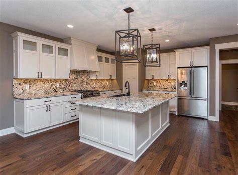 white kitchen cabinets beige countertop alaska white granite the shop in ankeny iowa 1787