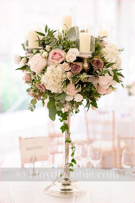 stunning tall floral centerpieces  candles