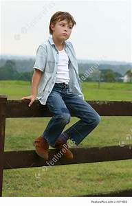 Country Boy Sitting On A Fence Picture  Sitting