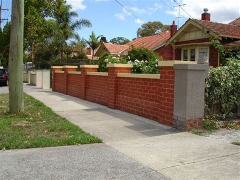 classic red brick fence  capping stone coloured