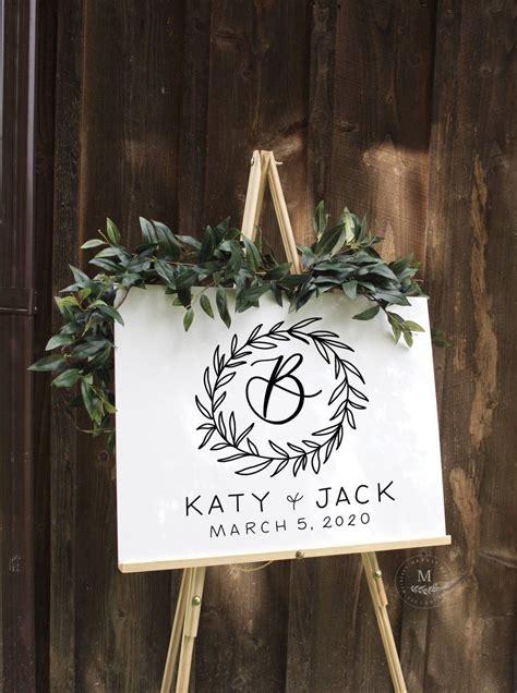 glossy white acrylic wedding  sign  leafy monogram brushed
