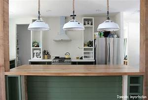 kitchen progress dark green cabinets a rustic wood countertop and lighting 2210