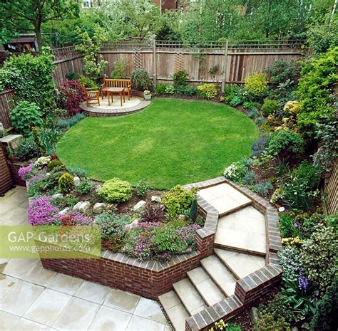 Suburban Backyard Landscaping Ideas by Gap Gardens Suburban Garden With Raised Lawn And