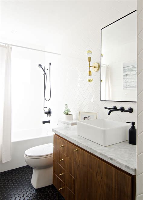 black white walnut bathroom with black faucet brass sconces brittanymakes the vintage
