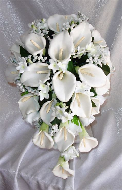 white  blue cascading bridal bouquet orchids peonies