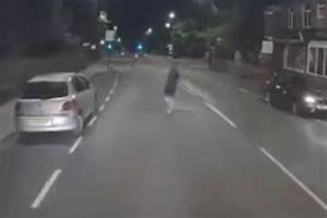 Watch heart-stopping moment angry man jumps in front of ...