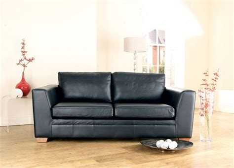 slipcover for leather sofa giving leather sofas a look with slipcovers