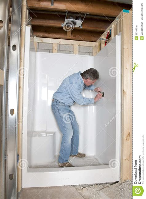 plumber install bathroom shower home remodel stock photo