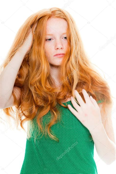 Pretty Girl With Long Red Hair Wearing Green Shirt