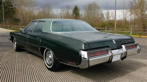 plain green wrapper 1973 buick lesabre with 16k miles
