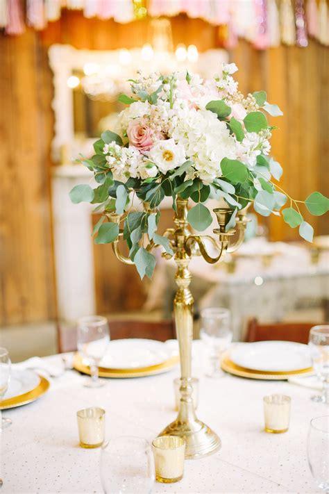 gold candelabra centerpiece  blush  ivory flowers