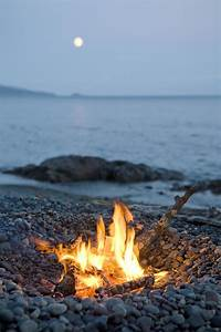 A Campfire On A Beach With A Full Moon Photograph by ...