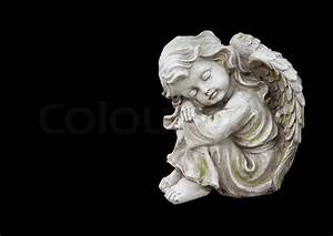 Sculpture of mourning angel isolated on black Stock