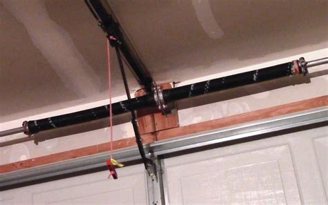 How To Adjust An Overhead Garage Door Spring — Acvap Homes