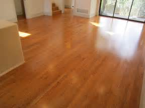 painting concrete floors to look like hardwood with brown color inside house with glass sliding