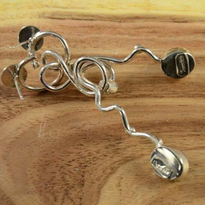 poblano asymmetric twisted earrings hoel s