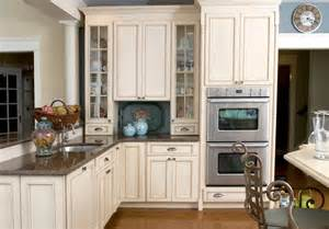 White Cabinets With Backsplash by Baltic Brown Granite Makes Your Kitchen Countertop Looks