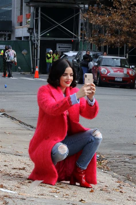 lucy hale looks cute in a pink fur coat while filming ...