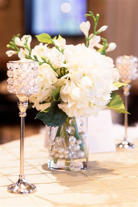 white hydrangea centerpiece  candles