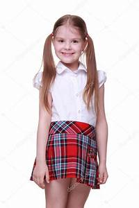 Portrait of little girl in white shirt and checkered skirt u2014 Stock Photo u00a9 Mari1Photo #24698059