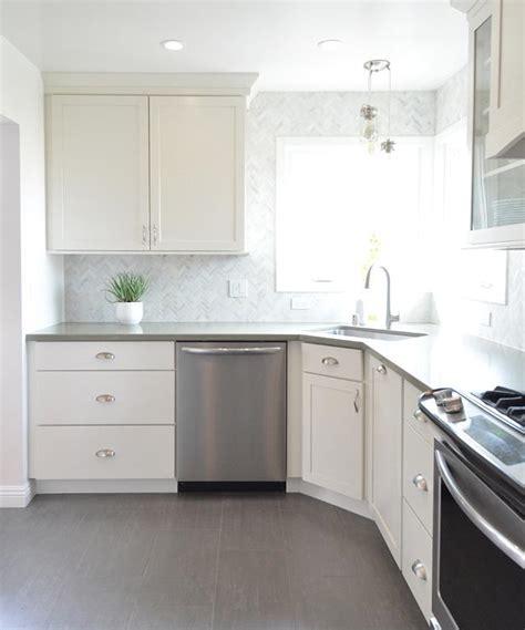 white kitchen  gray plank porcelain tile floor