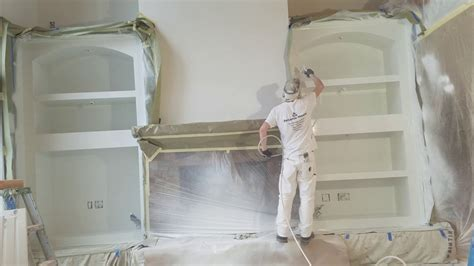 professionals spray paint built  cabinets