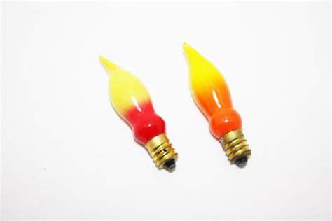 vintage christmas light bulbs flame light bulbs yellow