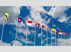 AEC Or ASEAN Flag Waving Atop Among Southeast Asia Nation