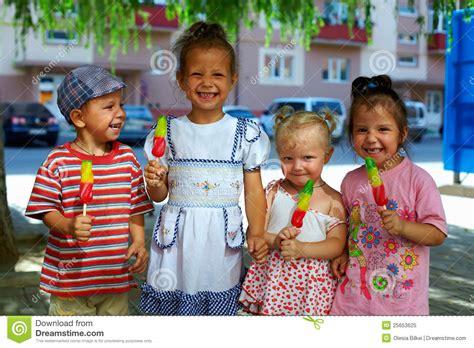 Group Of Happy Kids Eating Fruit Ice Cream Stock Image