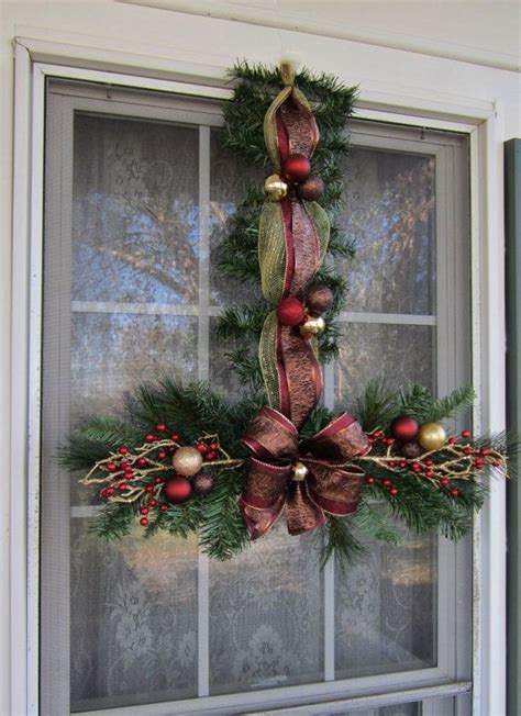 christmas window swags 140 best christmas swags wreaths images on pinterest christmas bunting christmas garlands