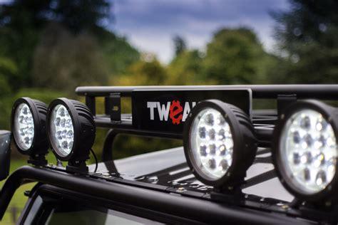 tweaked automotive builds land rover defender  spectre