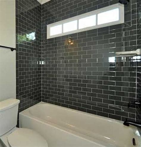 black subway tiles  guest bath black subway tiles
