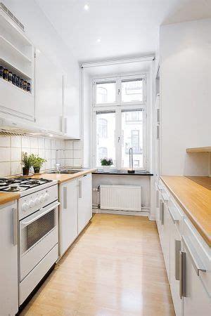 galley kitchenbutcher block counters  white