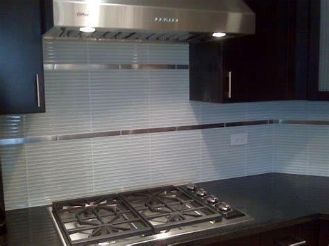 Skinny glass tiles with 1x12 stainless accent tiles. Cool