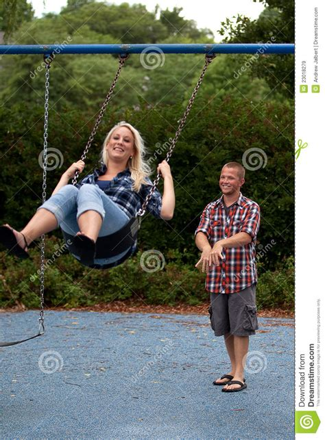 happy couple  swing set stock image image  blond