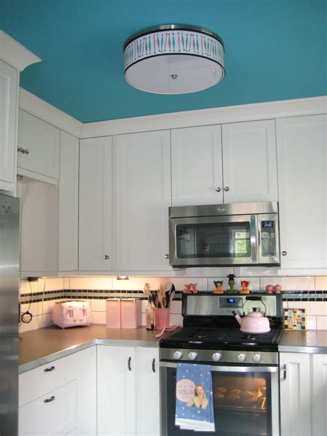 Even a slight shade darker or lighter will create a wonderful effect. Paint that ceiling with some color! | Kitchen cabinets ...