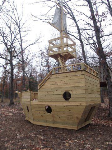 This wooden castle dollhouse is a fun project in the making for you and your kids. Wooden Pirate Ship Playhouse | Play houses, Playhouse plans, Build a playhouse