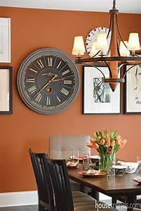 Bold burnt orange tone of sherwin williams39 copper for Kitchen colors with white cabinets with terracotta sun face wall art