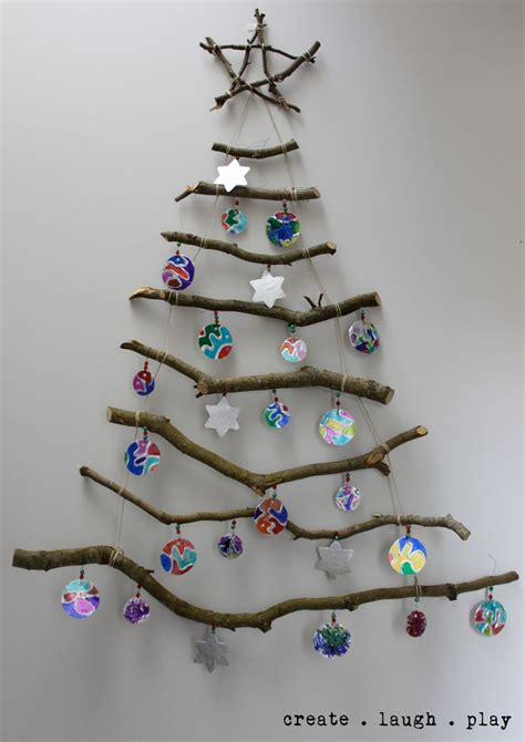 our wall hung stick xmas tree with the kids tinfoil